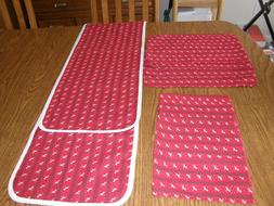 4 fabric place mats, 4 fabric napkins, and 1 fabric table ru