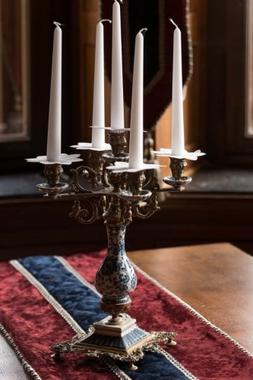 Decorative Candelabra and Candle on a Table with Runner Jour