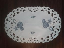 Place Mat or Doily Embroidered with Blue Seashells on Bleach